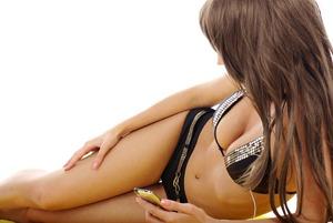 breast-augmentation-surgery-wesley-chapel-bigstock-woman-in-bikini-listening-music
